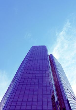 edifices: Corporate building against blue sky