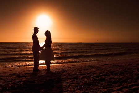 Couple holding hands on the beach photo