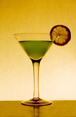 A glass of illusion with lime shot with 50mm photo