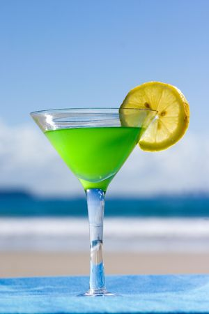 A glass of illusion with lime