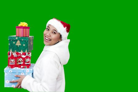 Happy Asian woman with santa hat carrying christmas gift photo