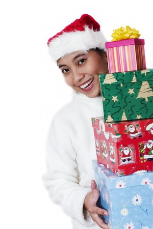 Happy Asian woman with santa hat carrying christmas gift Stock Photo - 240491