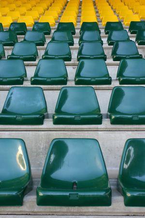 reserved seat: Empty stadium seats..