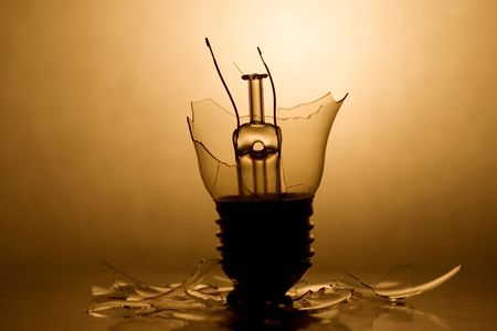 Broken Lightbulb with backlight and reflection photo