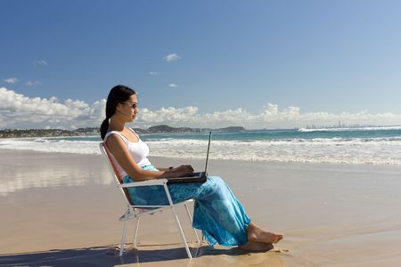 goldcoast: Asian woman Working at the beach Stock Photo