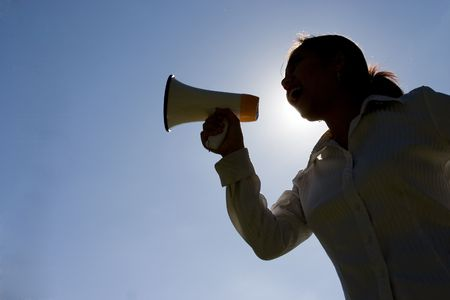 megaphone: Silhouette of woman shouting with a megaphone Stock Photo
