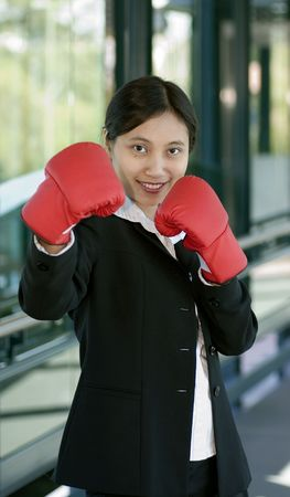 knock out: Businesswoman ready to knock out competitiors Stock Photo