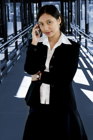 Attractive asian businesswoman with a mobile phone photo