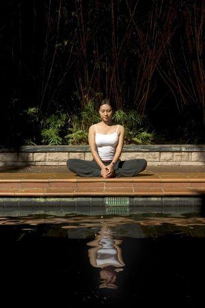 freed: Asian woman doing yoga