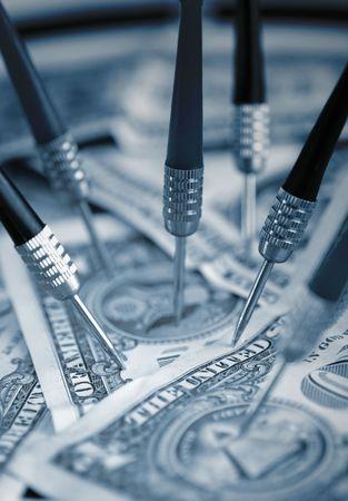 US Dollars and darts photo