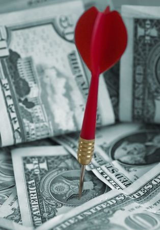 US Dollars and red dart photo