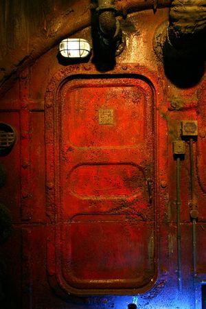 antique factory: Red rusted steel door