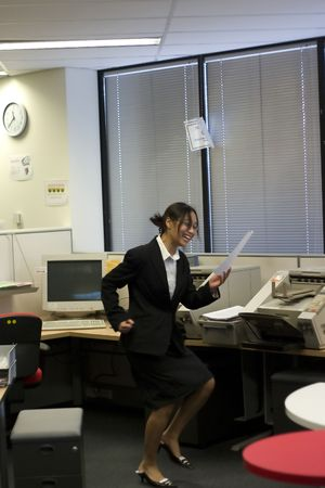 profit celebration: Excited businesswoman in her office Stock Photo