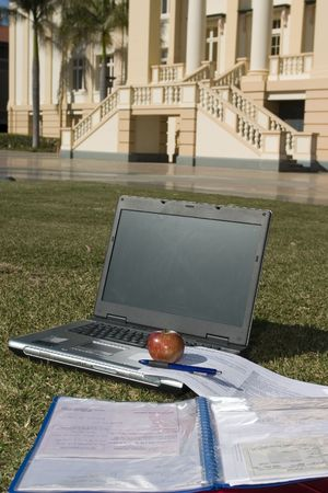 Laptop and lecture notes in front of a college building Stock Photo - 240169