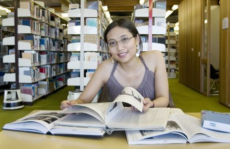 Asian woman studying in the library Stock Photo - 240164