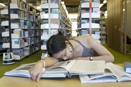 Asian woman studying in the library photo