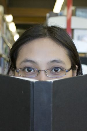Close up of a woman reading a book Stock Photo - 240163