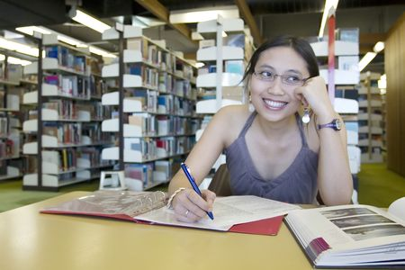 Asian woman studying in the library Stock Photo - 240162