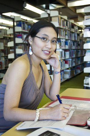 Asian student studying in the library Stock Photo - 240159