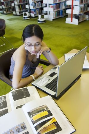 Asian student working with laptop in the library Stock Photo - 240156