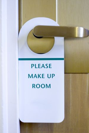 Please Make Up Room hotel sign with workspace photo