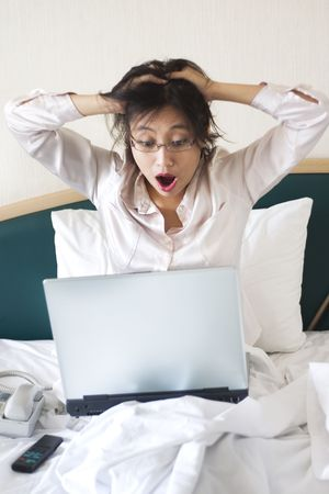 overwhelm: Shocked businesswoman in bed