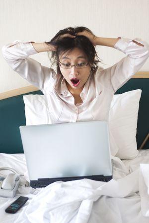 amaze: Shocked businesswoman in bed