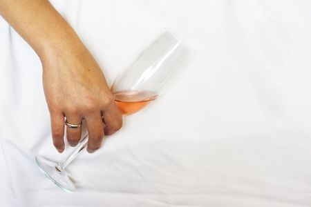 Drunken woman with a glass of wine.. Stock Photo
