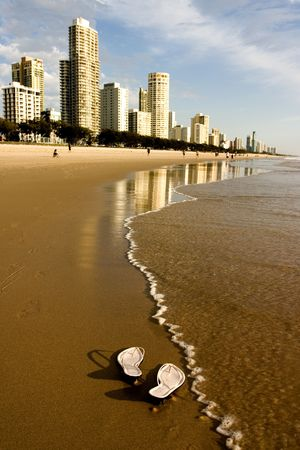 Woman sandals with beach apartments and resorts photo
