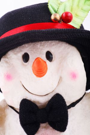 Cute snowman doll captured in close up over white background photo
