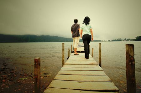 Young couple holding hands photo
