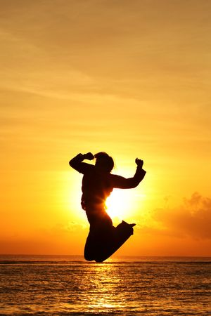 Silhouette woman jumping at the beach Stock Photo - 647986