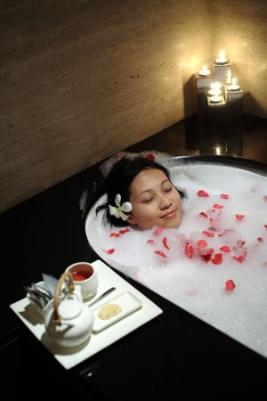 Chinese woman relaxing at the resort SPA Stock Photo - 648488