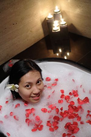 Chinese woman relaxing at SPA photo