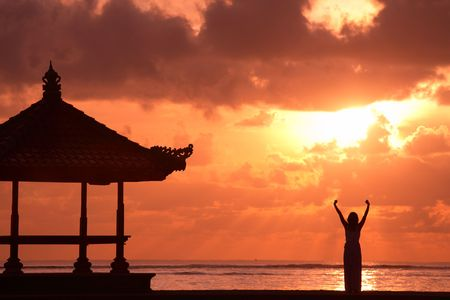 A person raising her/his hands at sunrise Stock Photo - 648253