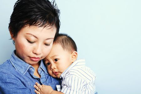 Isolated cute Asian baby boy with his mother photo