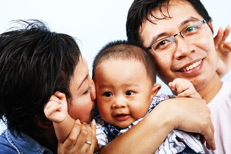 happy asian family: Happy asian family laughing and enjoying their time. Stock Photo