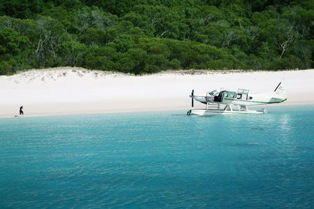 whitehaven: Aeroplane arrives on Whitehaven beach, Queensland, Australia