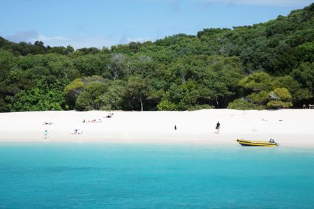 whitehaven beach: Whitehaven beach with tourists on holiday, Queensland, Australia
