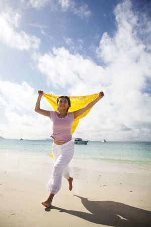 whitehaven: Asian woman running on beautiful whitehaven beach, Queensland, Australia Stock Photo