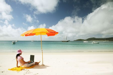 pink hat: Asian woman with pink hat working on the beach in Queensland, Australia Stock Photo