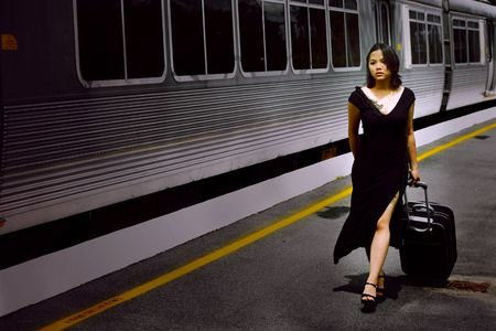 incoming: Business Woman waiting for the incoming train at Melbourne station, Australia