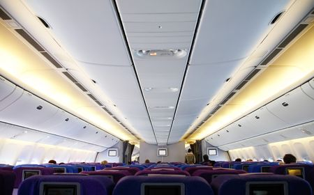 Interior photo of an anonymous airplane. Editorial