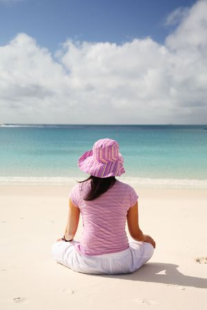 A woman relaxing on the beach in Whitsunday island Stock Photo - 744299