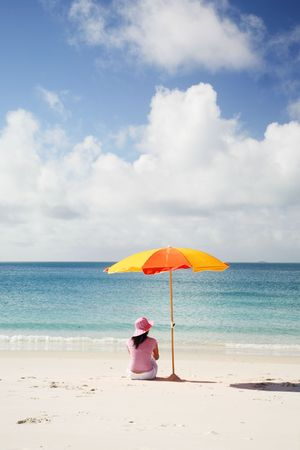 A woman relaxing on the beach in Whitsunday island Stock Photo - 744293