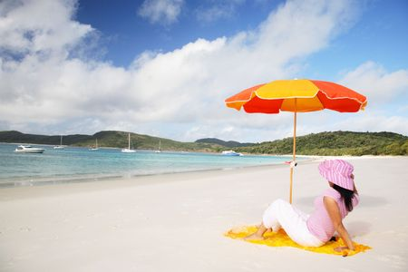 A woman relaxing on the beach in Whitsunday island Stock Photo - 744291