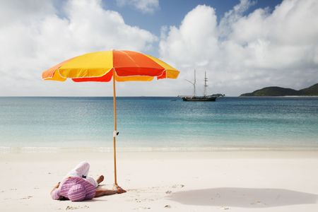 whitsunday: A woman relaxing on the beach in Whitsunday island; Australia Stock Photo