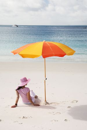 A woman relaxing on the beach in Whitehaven Beach, Whitsunday island Stock Photo - 744285