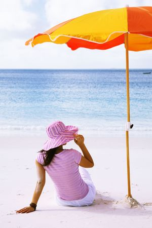A woman relaxing on the beach in Whitehaven beach, Whitsunday island Stock Photo - 744284