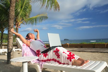 laptop outside: Asian businesswoman working on her vacation at the beach Stock Photo